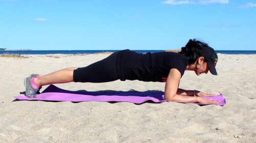 Aimee Borda performing a plank. This exercise is great for your core and can be done indoors or outdoors.